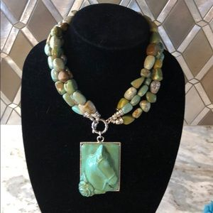 Green stone necklace with horse pendant